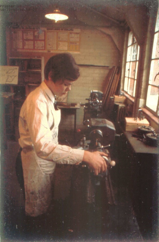 Chris Nelms operating one of the lathes in the metalwork shop, Farnham Garmmar School, early 1970s